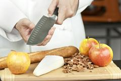 chef tests knife sharpness - stock photo