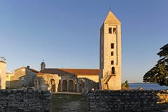 ruins and columns by bell tower, church of st john (ivan) the evangelist, tow - stock photo