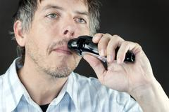 Man trimming mustache Stock Photos