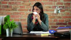 Sick businesswoman blowing nose in the office HD - stock footage