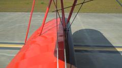 Biplane rolling on runway (airplane) Stock Footage