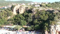 Village and beach below zoom out Stock Footage