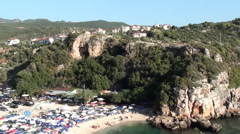 Village and beach below Stock Footage