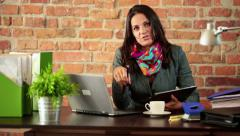Creative businesswoman with tablet talking to camera HD Stock Footage