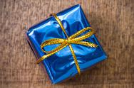 Stock Photo of blue gift box on the board