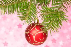 Stock Photo of red bauble on the fir branch