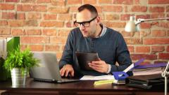 Multitasking young man working in modern office HD - stock footage