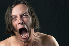 man screams in agony - stock photo