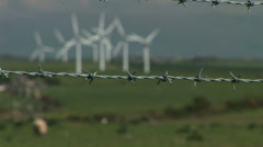 Barbed wire and wind turbines Stock Footage