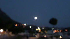 Full moon and town lights - stock footage