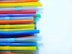 Colorful Drinking Straws on a White Background Stock Photos