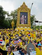 thai people wave flags during king bhumibol's birthday - stock photo