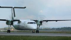 Commuter airplane taxing for take off front view Stock Footage