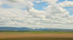 Timelapse of clouds over a field in Montana Stock Footage