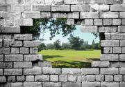 Stock Photo of old brickwall with countryside view
