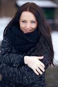 young brunette woman in the freezing cold park - stock photo