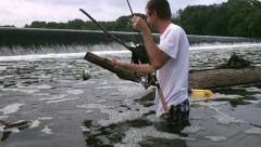 Man catch black crappie in slow motion Stock Footage