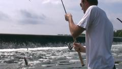 Man catch fish in slow motion Stock Footage