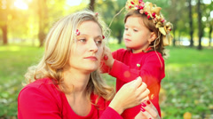 Mother and little daughter in a park Stock Footage