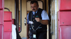 Ticket inspector collecting ticket Stock Footage