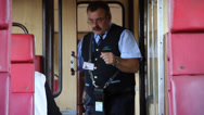 Stock Video Footage of ticket inspector collecting ticket