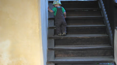 Independent little baby child climb the stairs Stock Footage