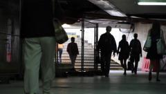People walk in tunnel 3 Stock Footage