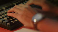 Lensbaby Typing on a Keyboard Stock Footage
