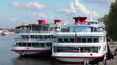 Two passenger cruise ships are moored in city river quay, Russia Stock Footage