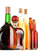 assorted alcoholic beverages isolated on white background - stock photo