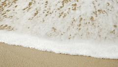 The waves and the sand on the beach close up Stock Footage