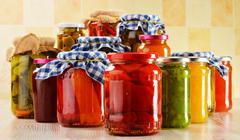 Composition with jars of pickled vegetables. marinated food Stock Photos