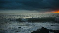 stormy sky over the ocean at sunset - stock footage