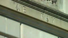 "IRS Building, DC,  CU ""...We Pay..."" inscription, zoom out. Stock Footage"