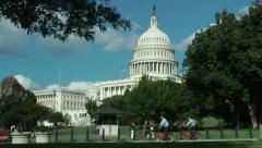 Capitol, 2 bikes whiz by, zoom from flag Stock Footage