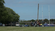 Stock Video Footage of Tossing the caber at the Highland Games in Cornhill, Scotland.