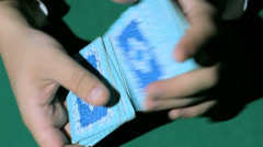 Two hands, shuffling a deck of cards. - stock footage