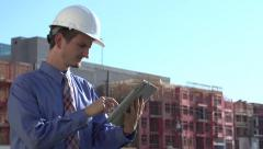 Construction man working out in heat Stock Footage