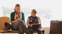 mother and son sitting in the Passenger Terminal - stock footage
