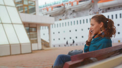 Young business woman sitting at the seaport Stock Footage