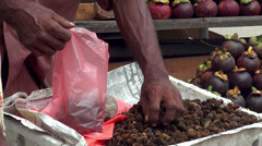Selling nuts in the fruit market Stock Footage