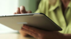 Close-up of a tablet computer in the hands of women aged Stock Footage