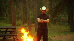 Cowboy watching bon fire Stock Footage