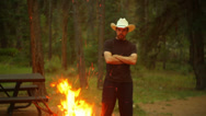 Stock Video Footage of cowboy watching bon fire