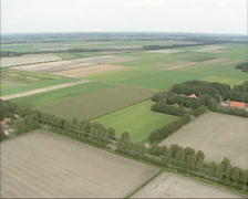 Aerial square land parcels and farms in reclaimed land of Noordoostpolder Stock Footage