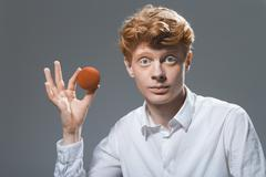 Portrait of young man holding ball, close up Stock Photos