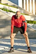smiling mature athletic man outdoors - stock photo
