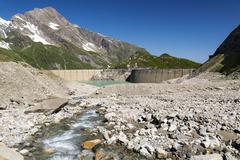 austria, mooserboden with masonry dam, the lake mooserboden and peak kitzstei - stock photo