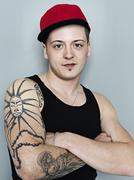 Portrait of young man with tattoos, smiling Stock Photos