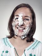 portrait of young woman face with chocolate marshmallow - stock photo